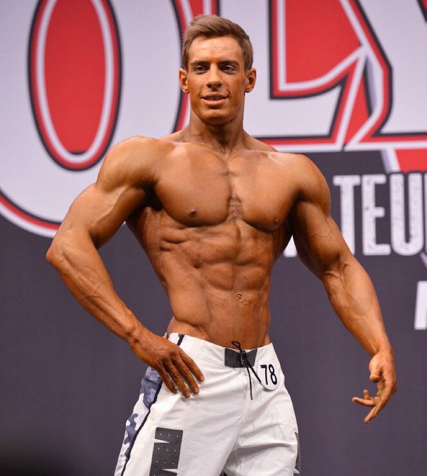 Nikolay Kuleshov on the Olympia stage, looking ripped and vascular
