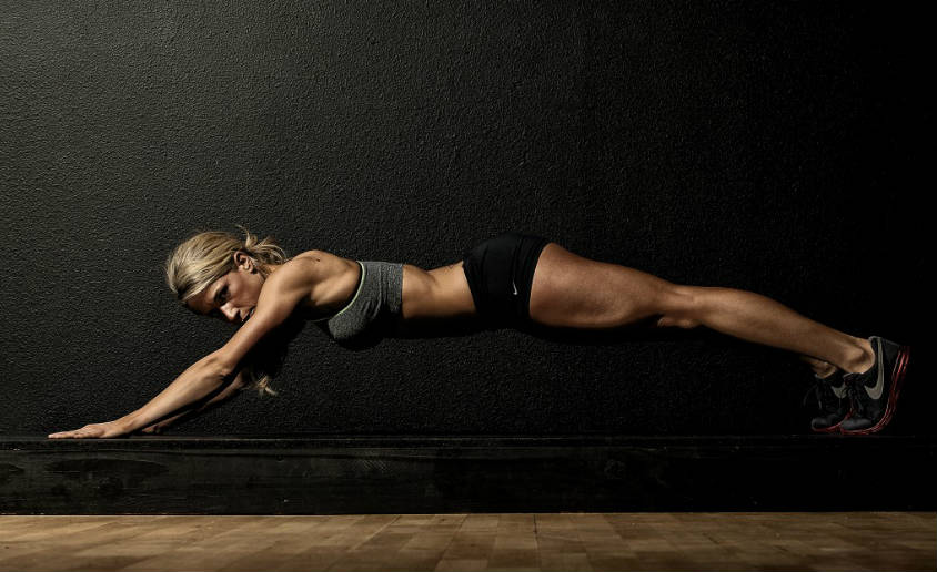 Rachel Elizabeth Murray completing a laying plank, showing her toned body and abs
