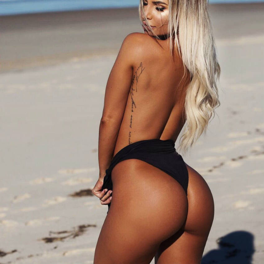 Rosanna Arkle showing her toned glutes and back on the beach