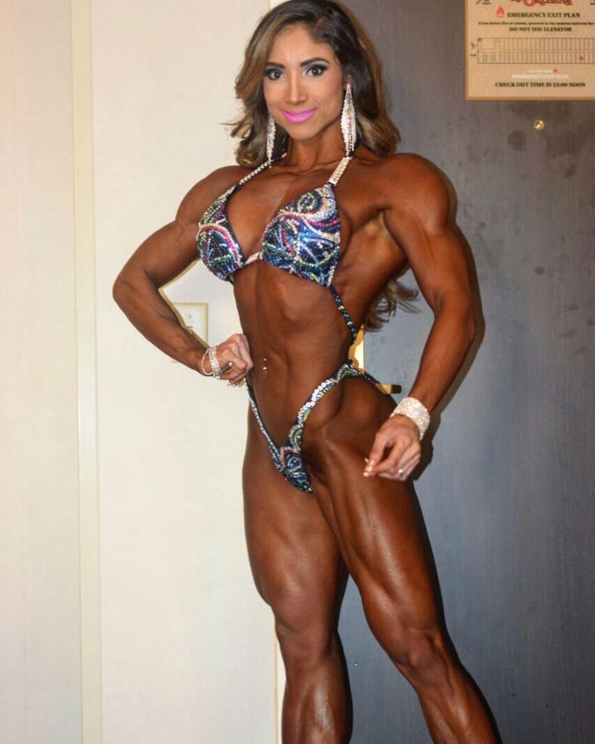 Sandra Grajales posing in a bikini, tanned up, looking muscular and fit
