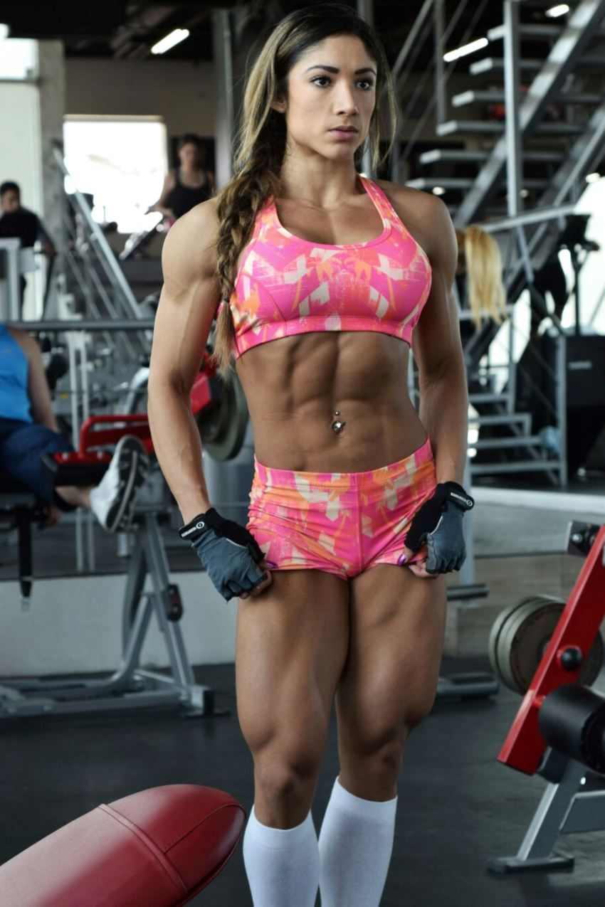 Sandra Grajales standing in the gym, showcasting her fit and lean body