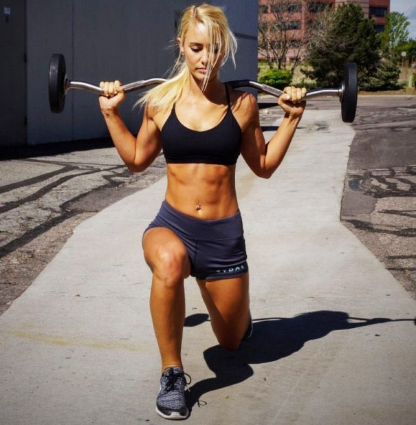 Shannon Henry performing walking lunges with a weight