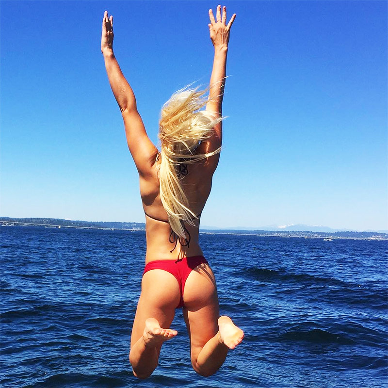 Shannon Henry jumping in the air in her bikini