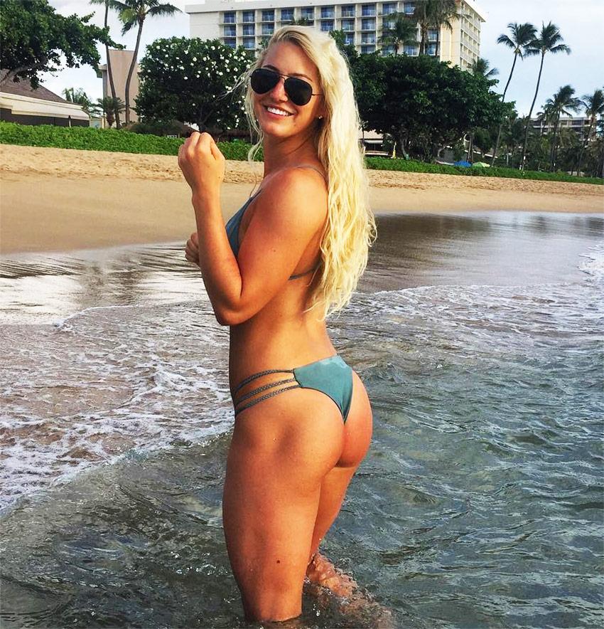 Shannon Henry posing in the sea in her bikini