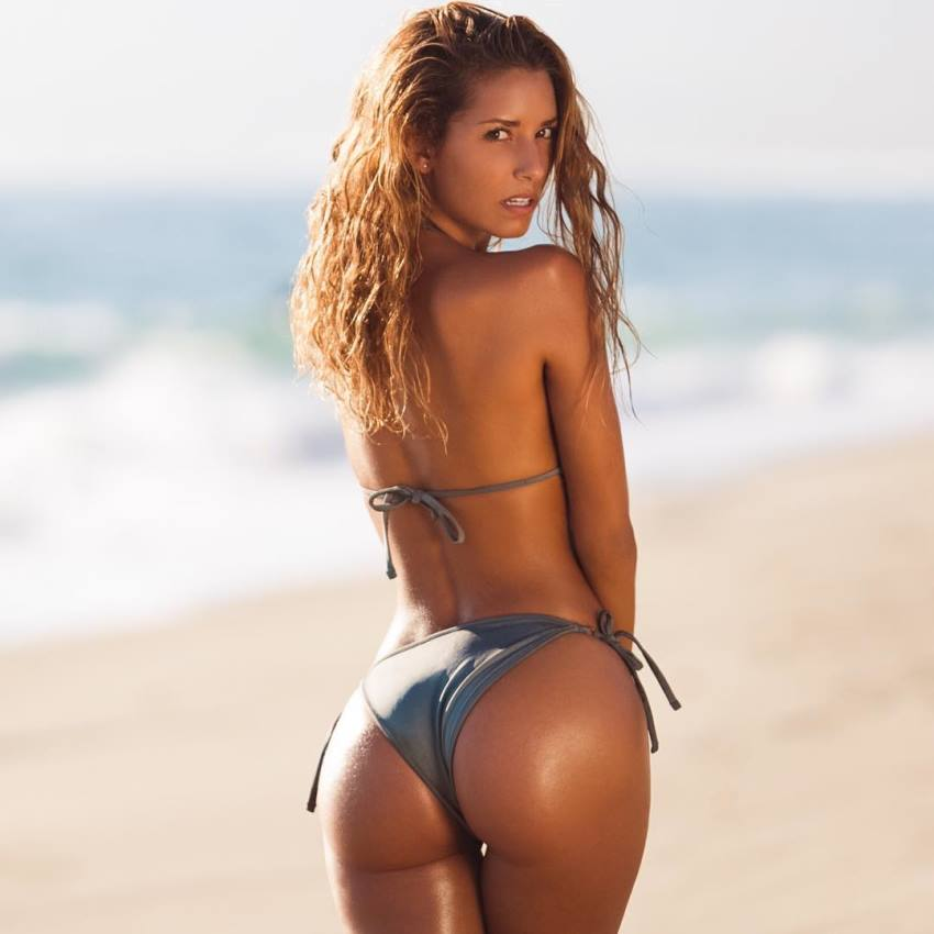 Sierra Skye on the beach in bikini, looking lean, fit, and aesthetic