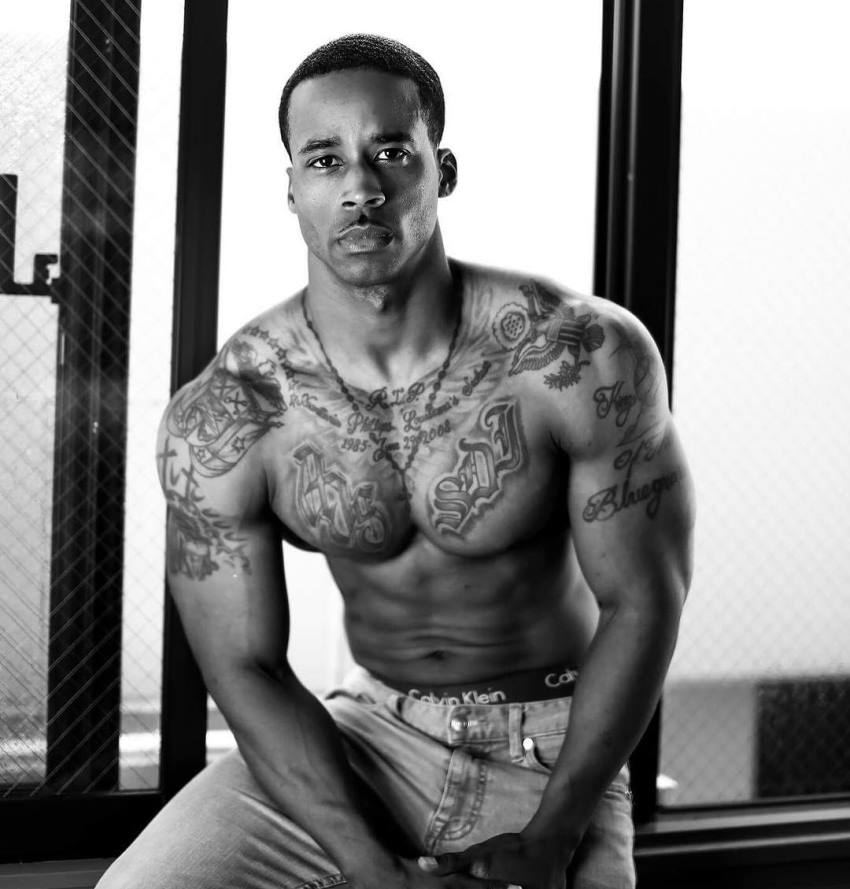 Andre Smith looking seriously at the camera, posing for a photoshoot, looking fit and healthy