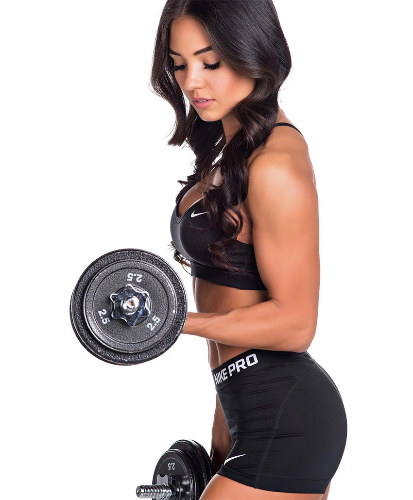 Ashley Flores lifting a dumbbell for a photoshoot
