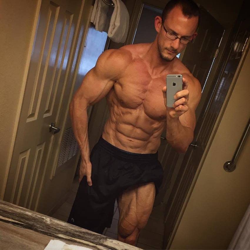 Brandon Gerdes taking a selfie of his ripped and aesthetic upper body and quads