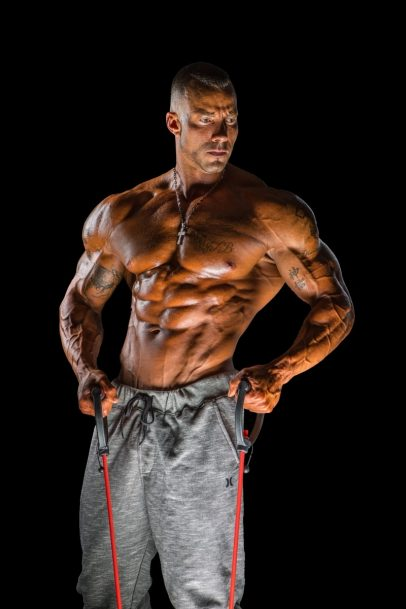 Brian Barthule posing for a photoshoot, looking big and ripped