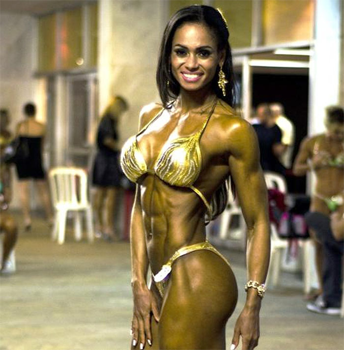 Denise Rodrigues posing in her competition bikini