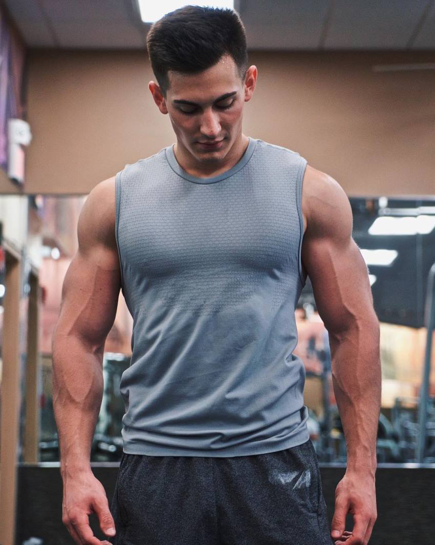 FaZe Censor in the gym in a grey sleeveless shirt, looking muscular and lean