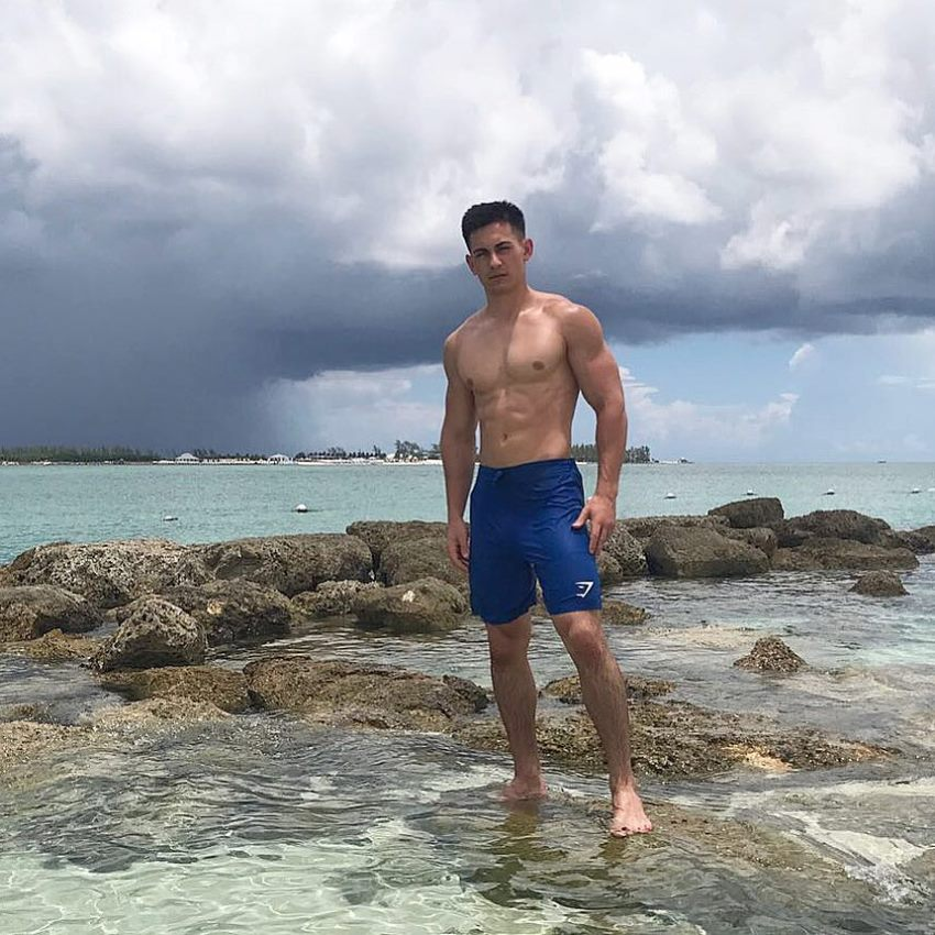 FaZe Censor standing in the shallow sea, looking lean and healthy