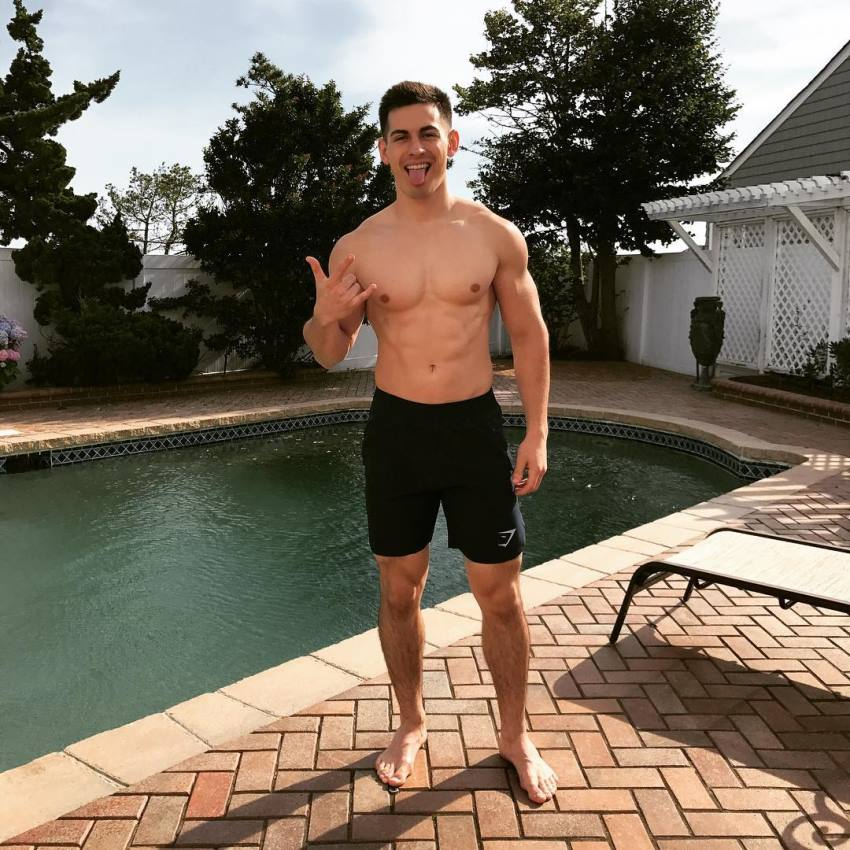 FaZe Censor standing by a pool making a gesture with his nad, looking lean and fit