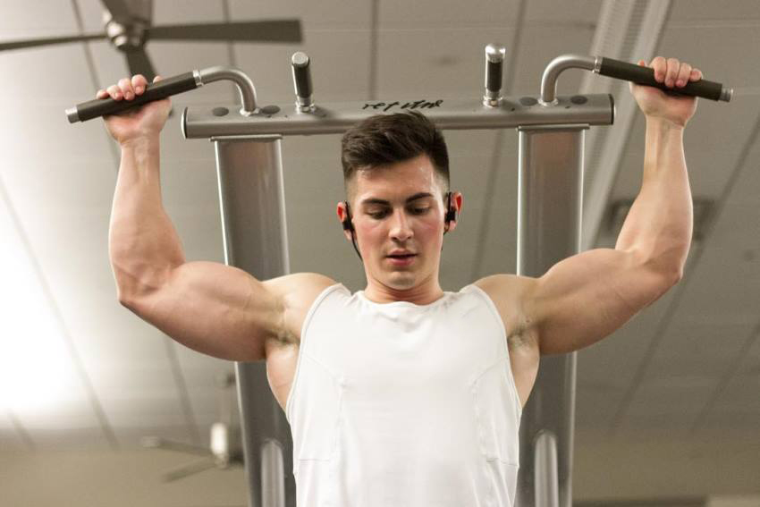 FaZe Censor doing pull ups behind the neck, his biceps popping out and looking ripped