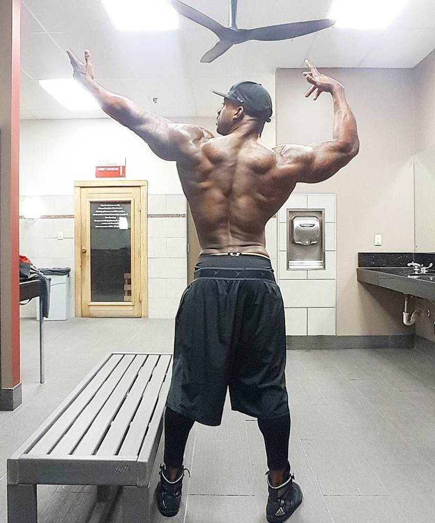 Jacques Lewis doing an old-school Frank Zane pose, showcasting his back, arms, and shoulders