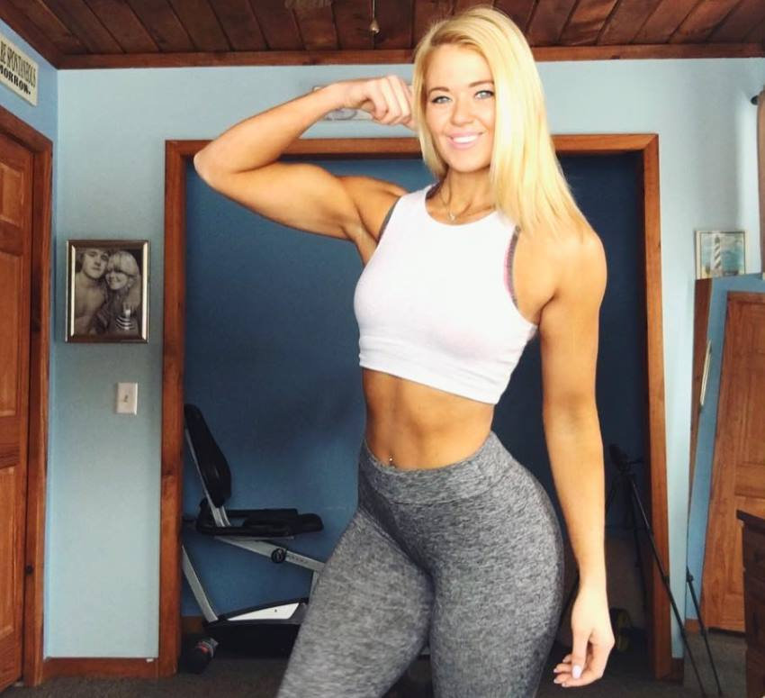 Leeci Knight flexing her lean biceps