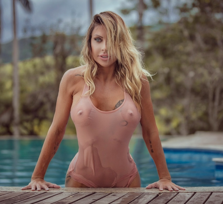 Luciane Hoepers getting out of the pool, showcasting her awesome body through transparent clothes