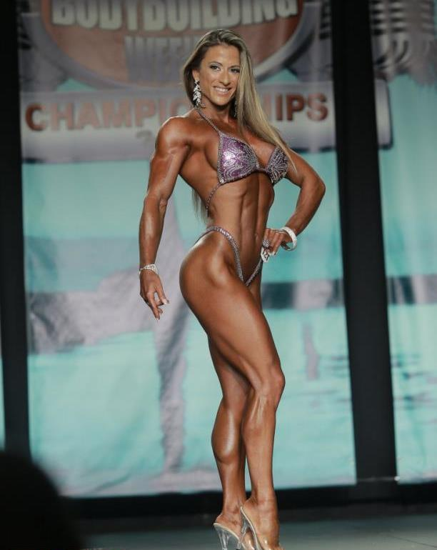 Maria Garcia on the bodyfitness stage, showing her ripped body to the judges