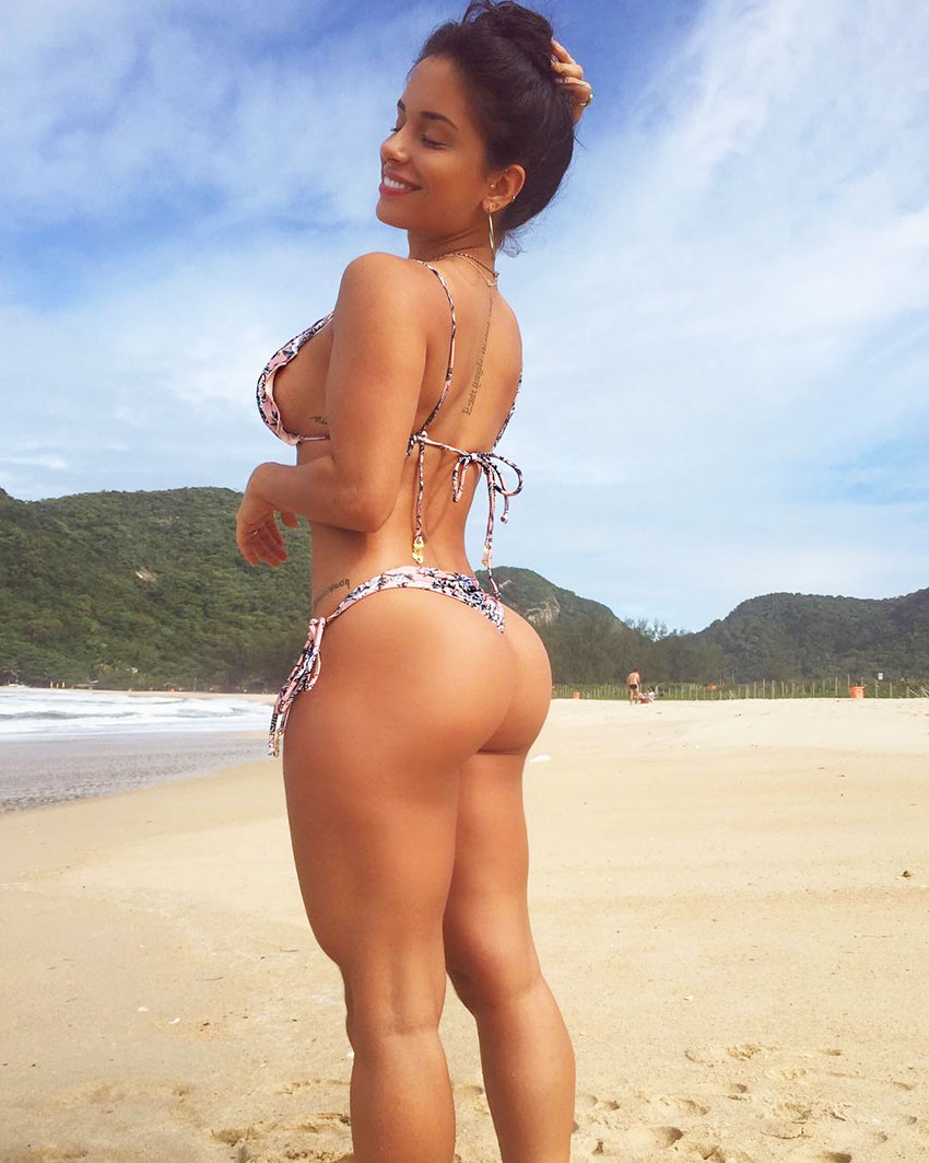Thamires Hauch standing on the beach showing off her large glutes looking lean, strong and healthy