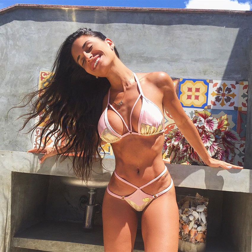Thamires Hauch wearing a bikini outside looking lean and healthy