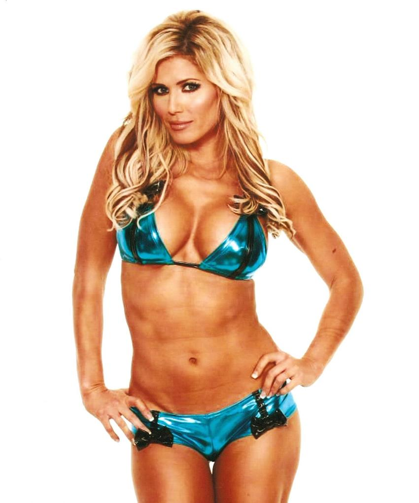 Torrie Wilson in her shiny blue bikini, looking lean and fit