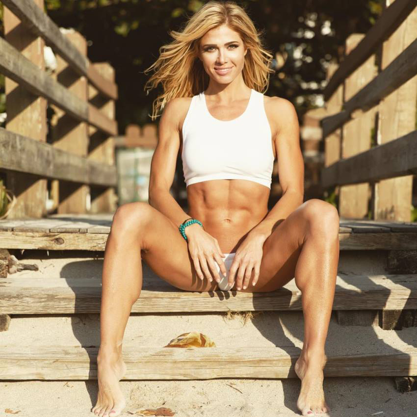 Torrie Wilson sitting on a porch, looking lean and fit