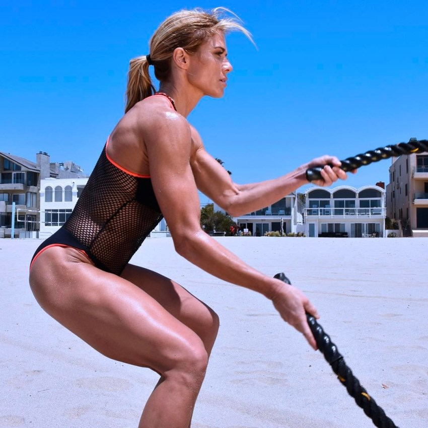 Torrie Wilson exercising with ropes on the beach, looking aesthetic