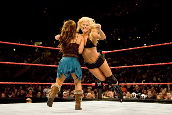 Torrie Wilson fighting against another female wrestler in a ring