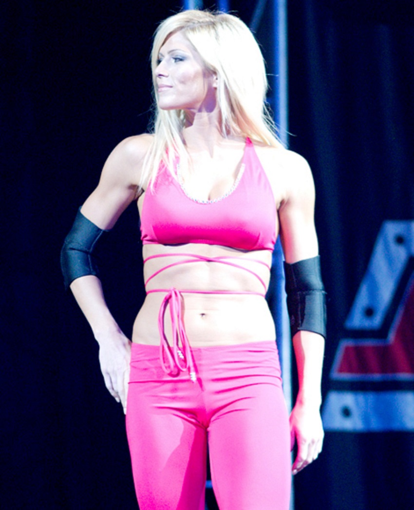 Torrie Wilson walking out on the big WWE stage, looking confidently at the public
