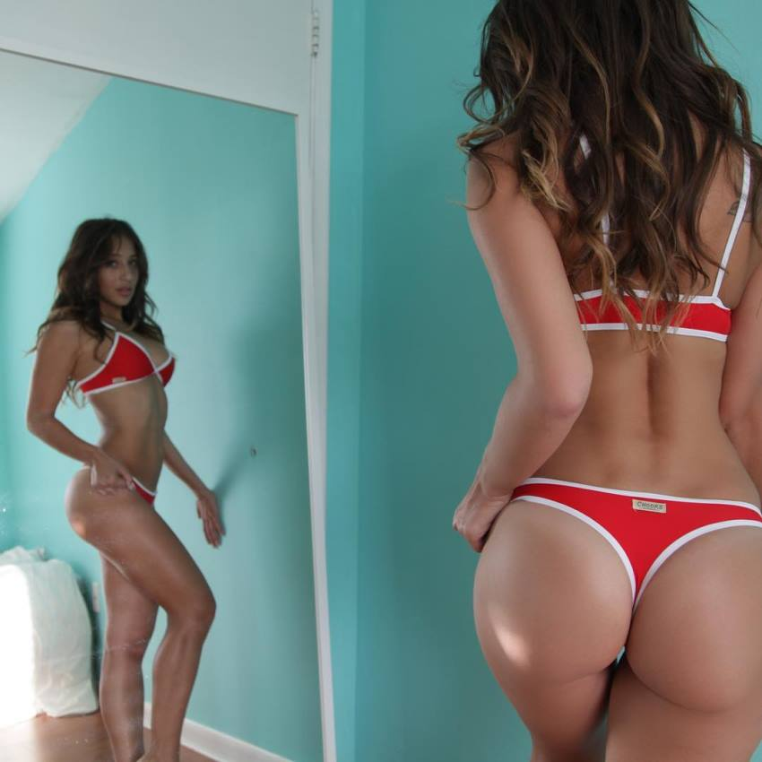 Vicky Justiz looking at her lean and sculpted body in the mirror, her glutes and legs looking amazing