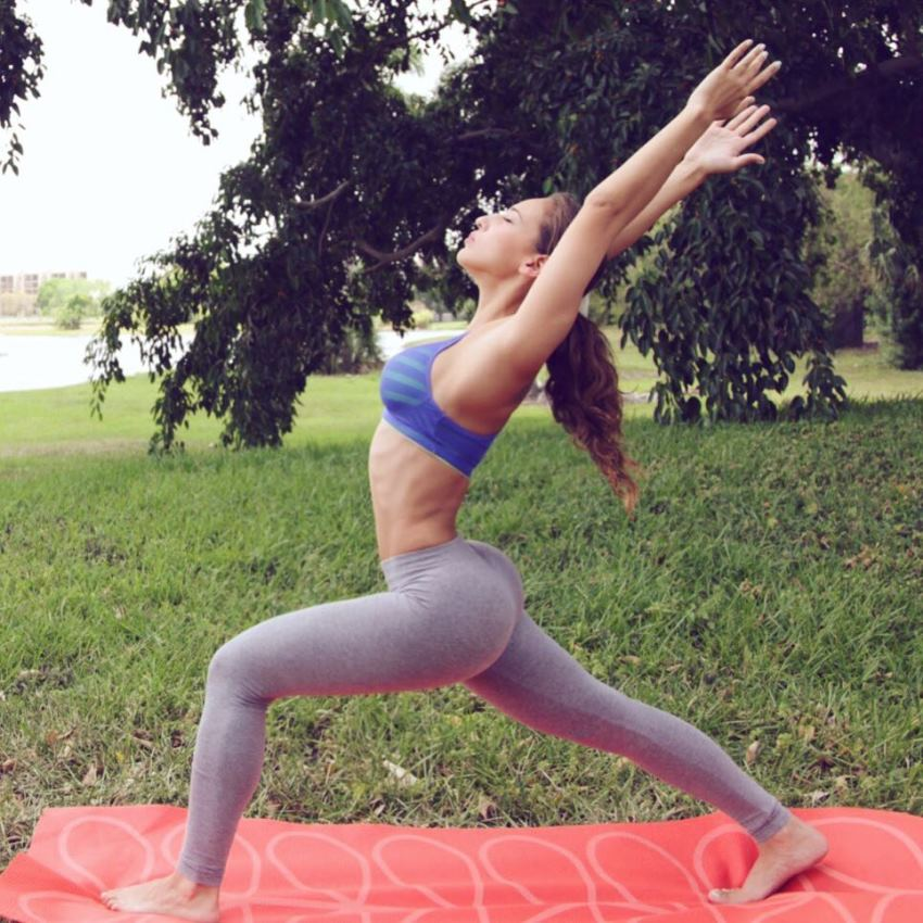 Vicky Justiz doing yoga stretches and exercises outdoors, her legs and glutes looking awesome in grey yoga pants