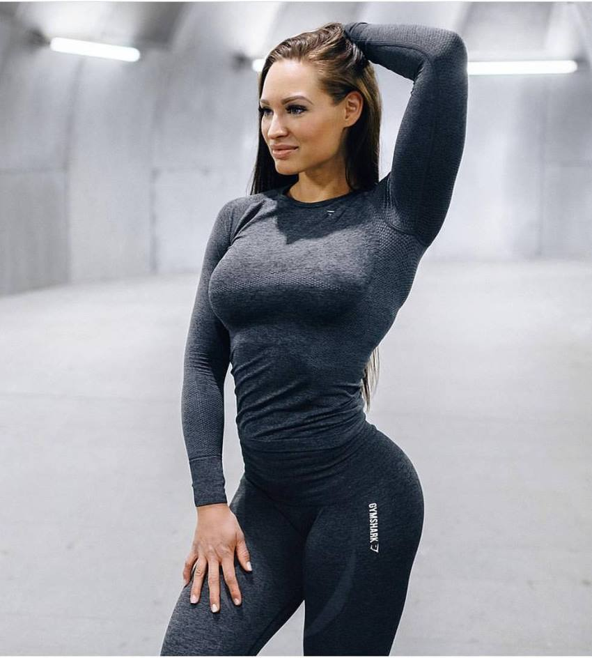 Christina Fjaere posing for a photo in a gym wear