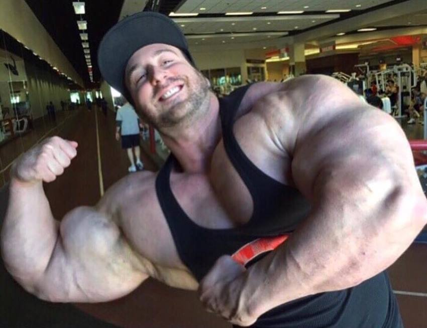 Craig Golias flexing his huge biceps