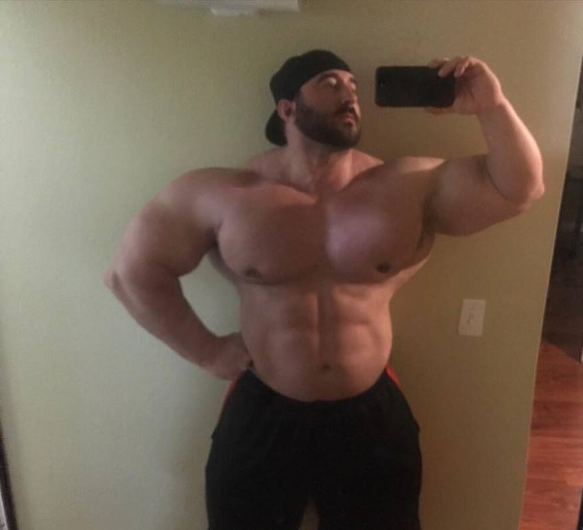 Craig Golias taking a selfie of his huge physique