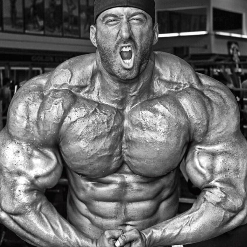 Craig Golias doing a shirtless most muscular pose