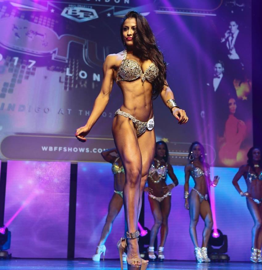 Christina Silva standing on the WBFF, smiling and looking ripped