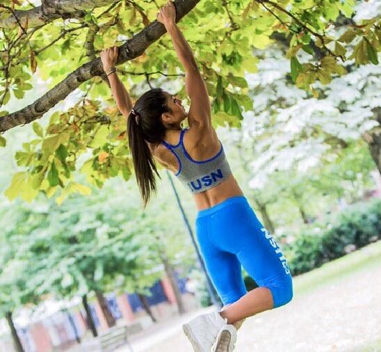 Cristina Silva doing pull ups on a tree