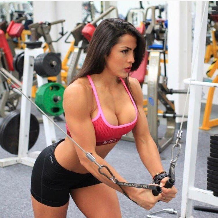 Cristina Silva doing cable crossovers in the gym, looking fit and healthy