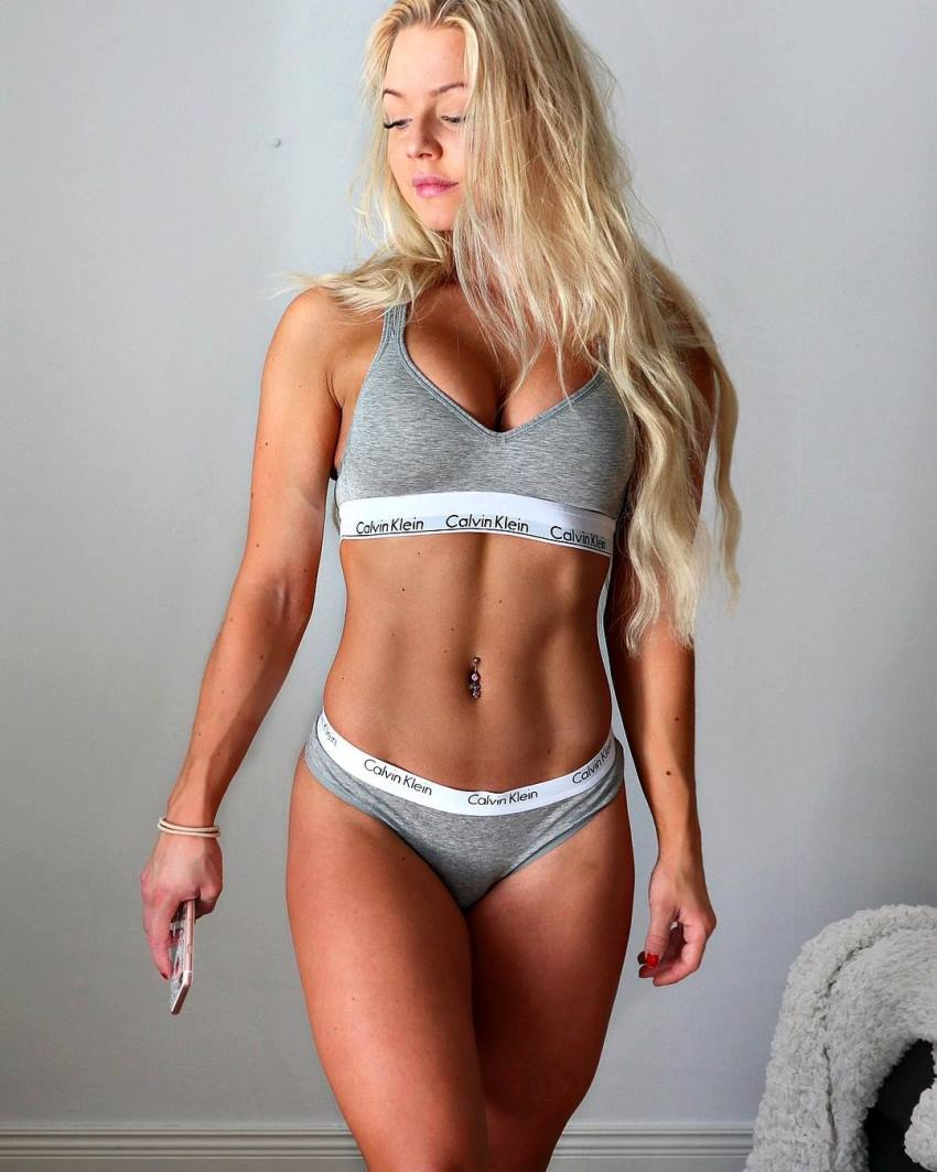 Denice Moberg showcasting her ripped and toned abs