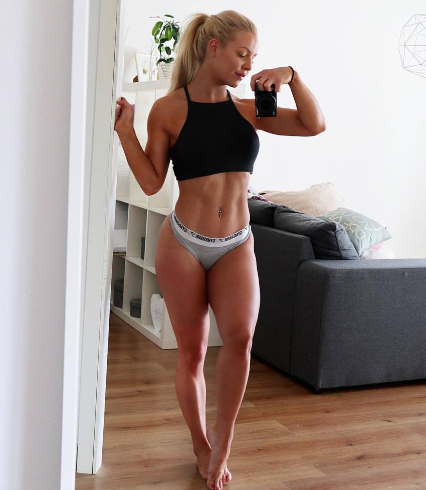 Denice Moberg taking a photo of her lean abs and legs