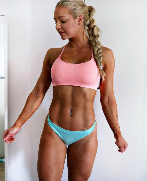 Denice Moberg posing for a photo in a pink bra looking fit