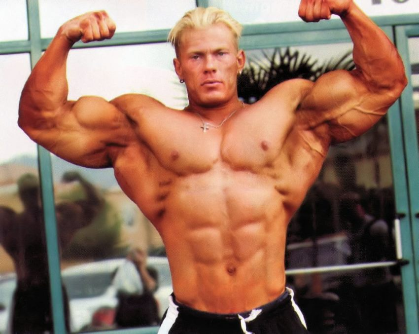 Dennis Wolf in his younger days, doing a front double biceps pose