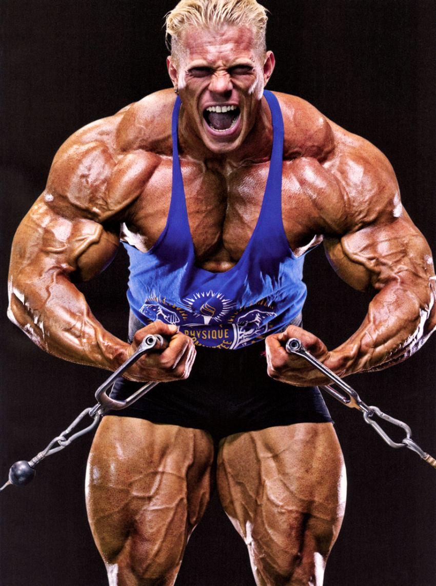 Dennis Wolf doing cable curls with a pained grimace