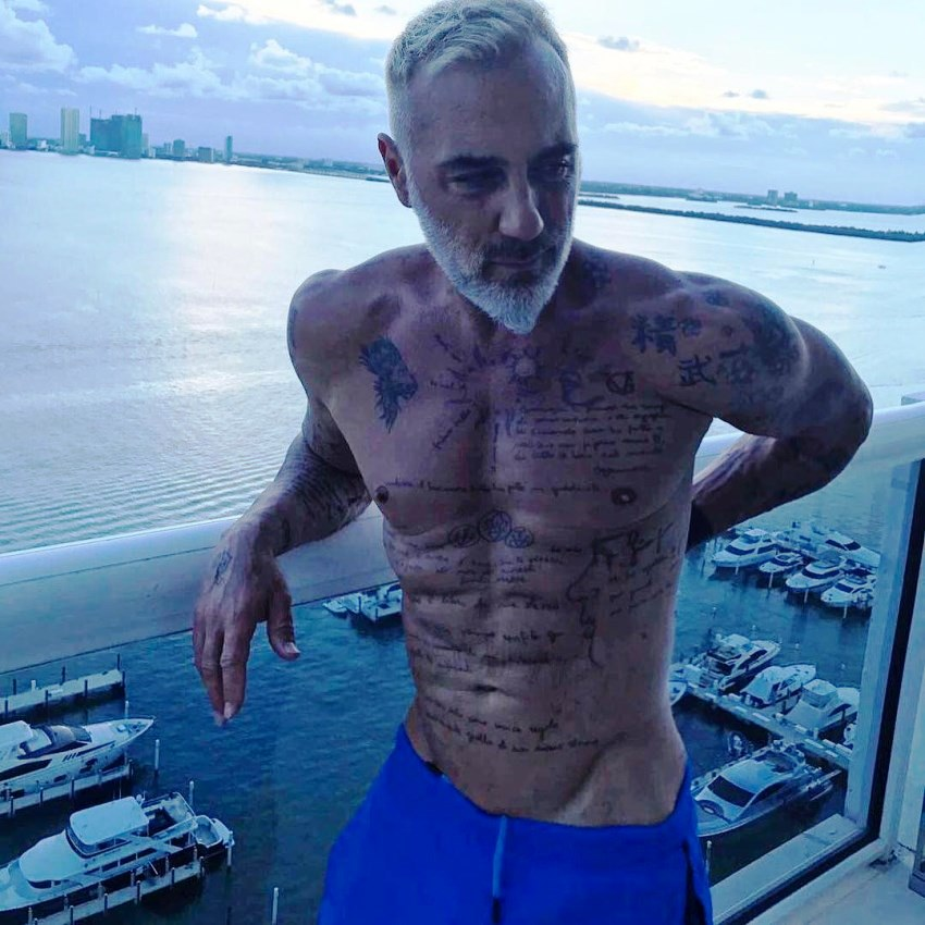 Gianluca Vacchi on top of a skyscraper in Miami, overlooking beautiful sea scenery
