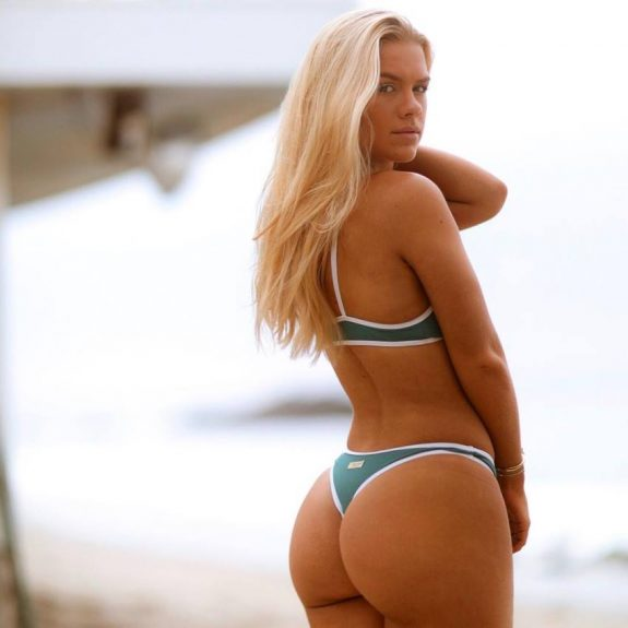 Grace Beverley showcasting her glutes on a beach