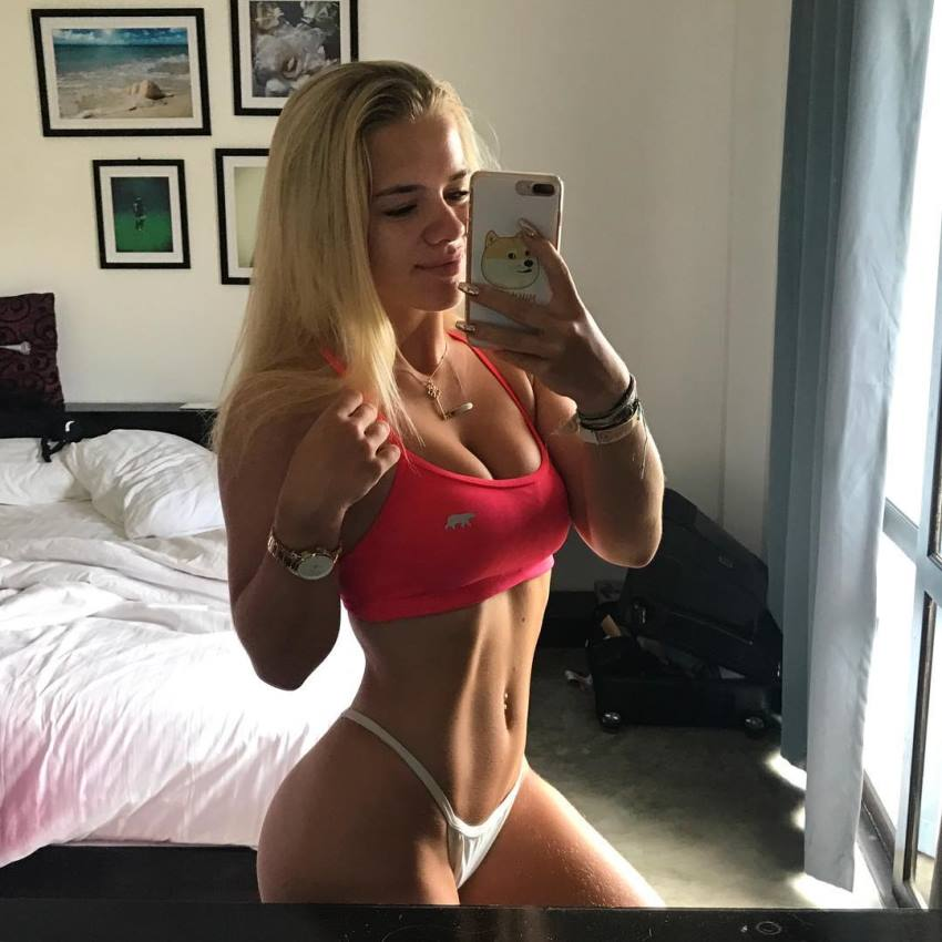 Grace Beverley taking a selfie of her fit abs