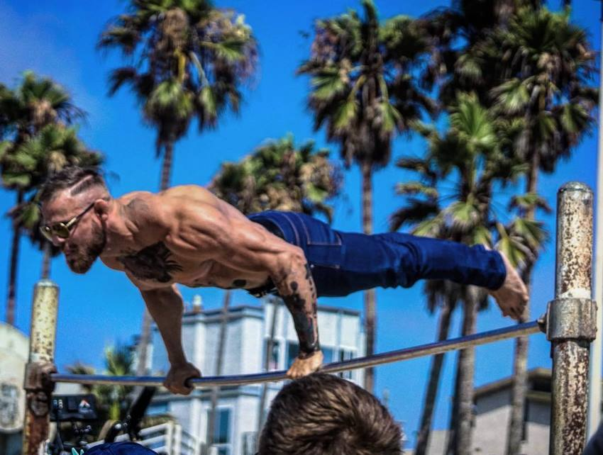 Islam Badurgov doing calisthenics outdoors shirtless