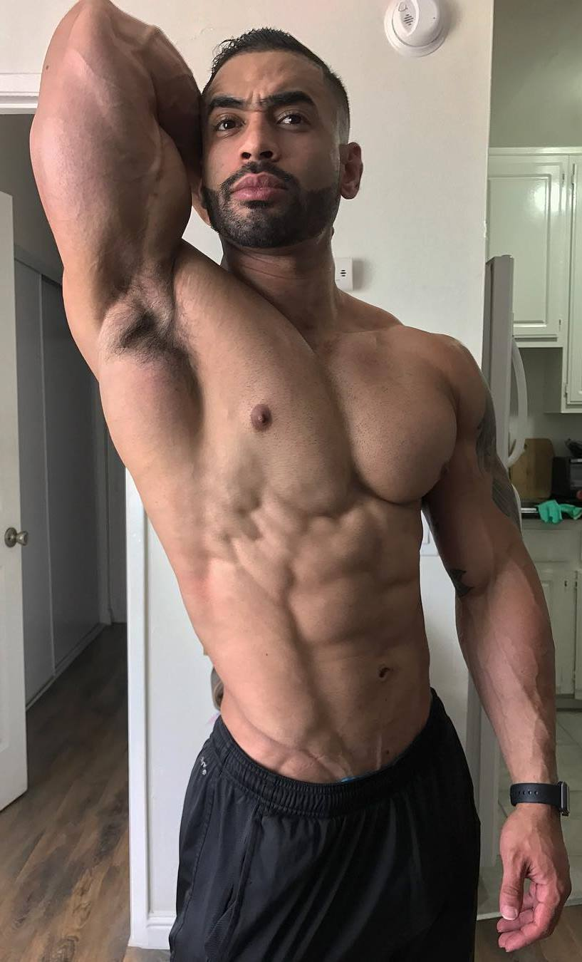 Jamie LeRoyce flexing his abs and obliques at home, looking ripped