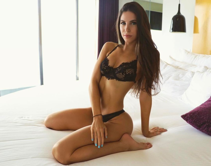 Jen Selter in black lingerie on a bed