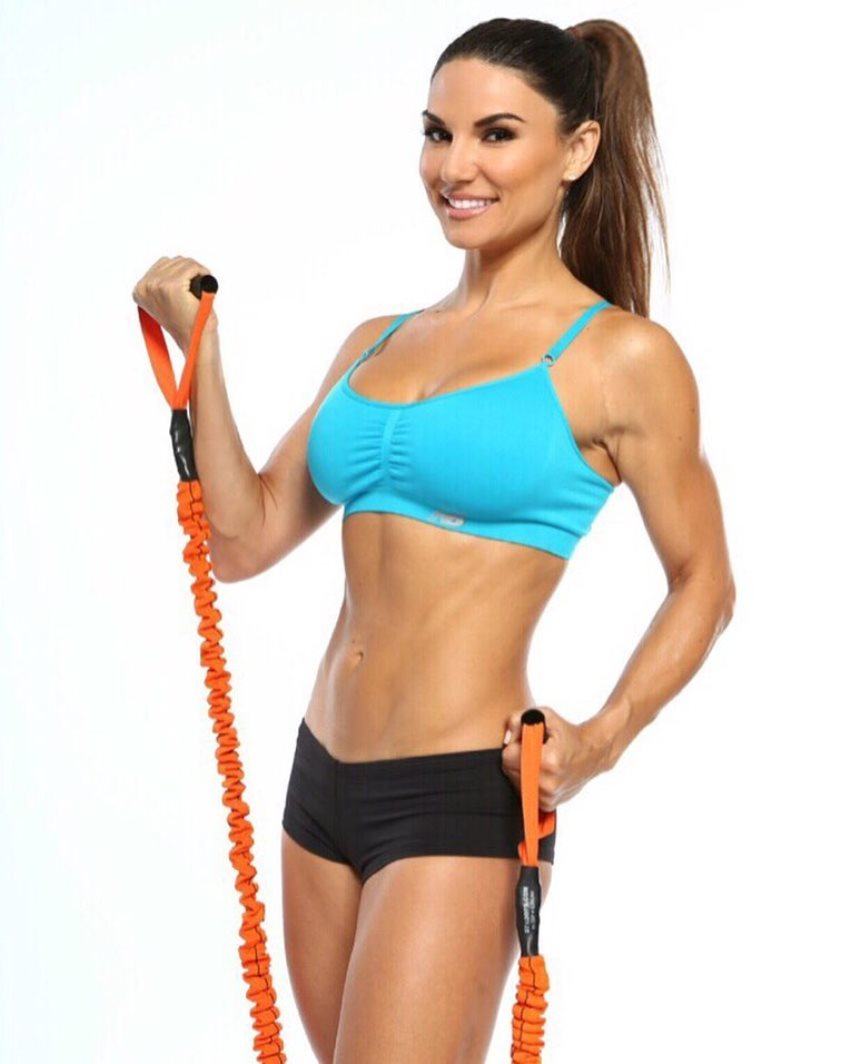 Lauren Abraham doing an exercise with a resistance band